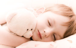 Sleeping child with toy Stock Photography