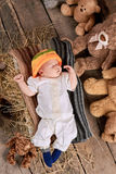 Sleeping child on wooden background. Royalty Free Stock Photos