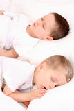 Sleeping children. Two sleeping children in white bedclothes Stock Photography
