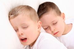 Sleeping children. Two sleeping children in white bedclothes Royalty Free Stock Images