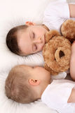 Sleeping children. Two sleeping children in white bedclothes Royalty Free Stock Image