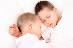 Sleeping children. Two sleeping children in white bedclothes Royalty Free Stock Photos