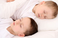 Sleeping children. Two sleeping children in white bedclothes Stock Images