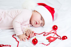Sleeping Christmas baby girl Stock Photography