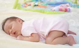 Sleeping chubby baby girl sleeping. Little chubby girl calmly sleeping on the tummy royalty free stock images