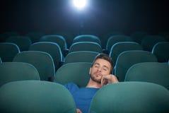 Sleeping at the cinema Stock Photo