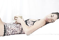 Sleeping with the coffee Stock Photography