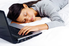 Sleeping on computer woman Stock Images