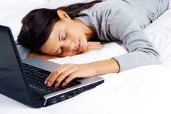Sleeping on computer woman Stock Images