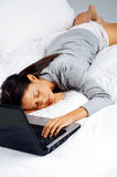 Sleeping on computer woman Stock Image