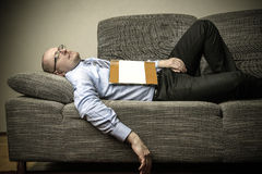 Sleeping on the couch Royalty Free Stock Photos