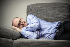 Sleeping on the couch Royalty Free Stock Photo
