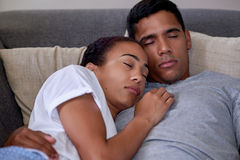 Sleeping couch couple portrait Stock Images