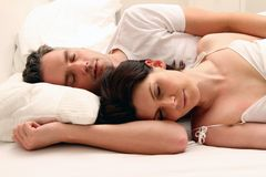 Sleeping Couple. Couple laying in bed and sleeping royalty free stock images