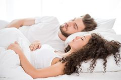 Sleeping couple in the bed Royalty Free Stock Photos