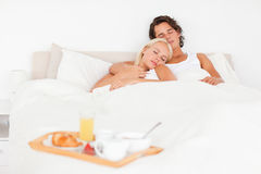 Sleeping couple with the breakfast Royalty Free Stock Photo