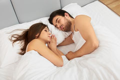 Sleeping couple lying in their bed in the bedroom Royalty Free Stock Image
