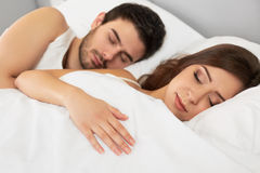 Sleeping Couple Lying in Their Bed in The Bedroom Stock Images