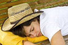 Sleeping cowgirl Stock Images