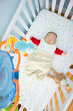 Sleeping in Crib time. 4 Month Old baby in baby crib sleeping in crib Stock Image