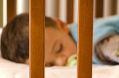 Sleeping cute baby. Closeup picture of sleeping cute baby. Focus on baby bed Royalty Free Stock Image