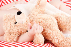 Sleeping cute little baby on red and white stripes pillow Stock Photo