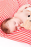 Cute little baby todler infant lying on blanket Stock Photo