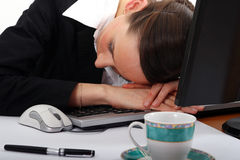 Sleeping on desk Royalty Free Stock Image
