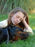 Sleeping dog and woman Royalty Free Stock Photo