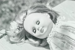 Sleeping doll in black and white Stock Photo