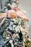 Sleeping doll child in bunny costume on Christmas tree Royalty Free Stock Images