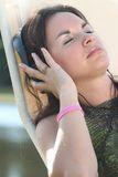 Sleeping and dreaming. Young attractive woman with her eyes closed listening to music Royalty Free Stock Photography