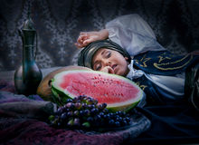 Sleeping eastern boy after lunch Royalty Free Stock Images
