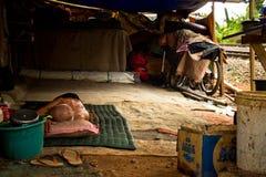 Sleeping elderly man of the train track slums of central Jakarta Stock Photography