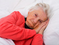 Sleeping elderly. Portrait of a beautiful sleeping elderly lady Royalty Free Stock Images