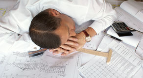 Sleeping engineer- planner Stock Images