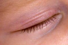Sleeping eye. A closed baby eye - detail Stock Photography