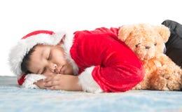 Sleeping fat boy waiting for Santa Stock Photos