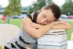 Sleeping female student Royalty Free Stock Photo