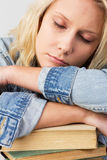 Sleeping female student Stock Images
