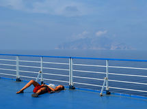 Sleeping on ferry deck Stock Photography