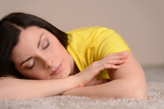 Sleeping on the floor. Close-up of beautiful middle-aged women s Stock Images