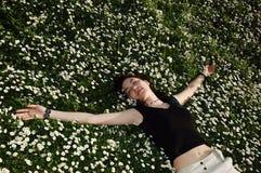 Sleeping the flowers. Girl sleeping in the flowers Stock Photos
