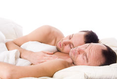 Sleeping gay couple royalty free stock photography