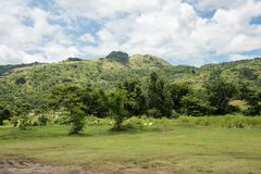 Sleeping Giant Mountain. With the lush, tropical, and green landscape under a blue sky with clouds in Port Denarau, Fiji Stock Image