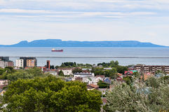Sleeping giant thunder bay. View of downtown Thunber Bay Ontario, Canada north ward and harbour from Hillcrest Park, with Sleeping Giant in background royalty free stock images
