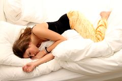 Sleeping Girl. Beautiful brunette girl sleeping in bed royalty free stock photography