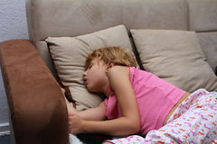 The sleeping girl. On the couch Royalty Free Stock Images