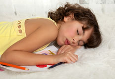 Sleeping girl Stock Images