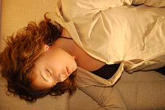 Sleeping girl. Young girl sleep on a couch stock images